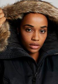 Peak Performance - LOCAL  - Zimní kabát - black - 4