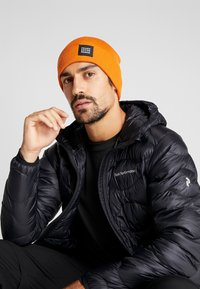Peak Performance - SWITCH HAT - Muts - orange - 1