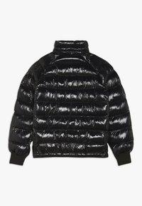 Peak Performance - TOMIC - Winter jacket - black - 2
