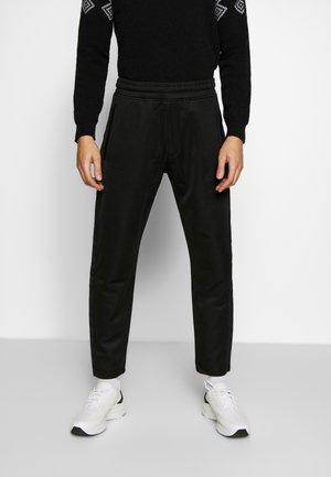 LUX PANTS - Tracksuit bottoms - black