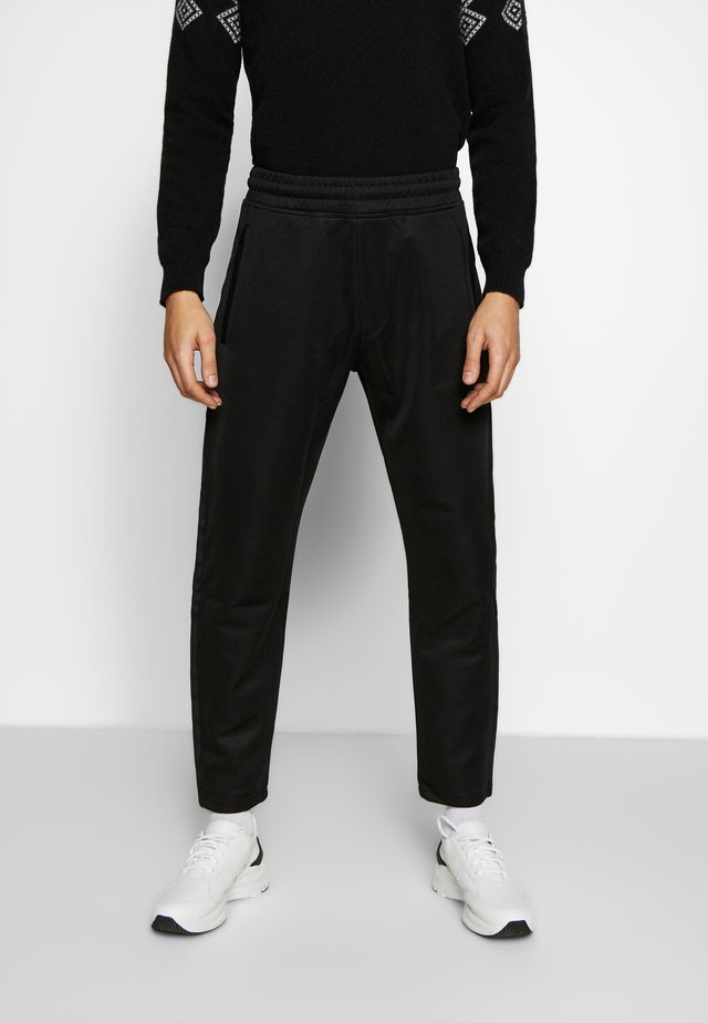 LUX PANTS - Jogginghose - black