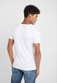 Peak Performance Urban - URBAN TEE - T-paita - white - 2