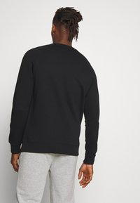 Peak Performance Urban - URBAN CREW - Sweatshirt - black - 2