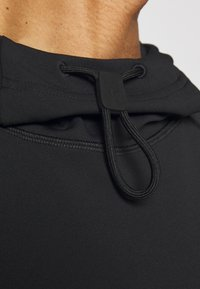 Peak Performance Urban - EXTENDED SHORTSLEEVE HOOD - T-shirts print - black