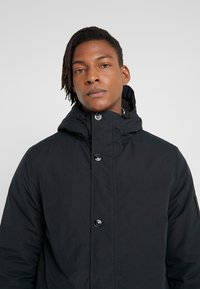 Peak Performance Urban - TYPHON JACKET - Abrigo de invierno - black - 3