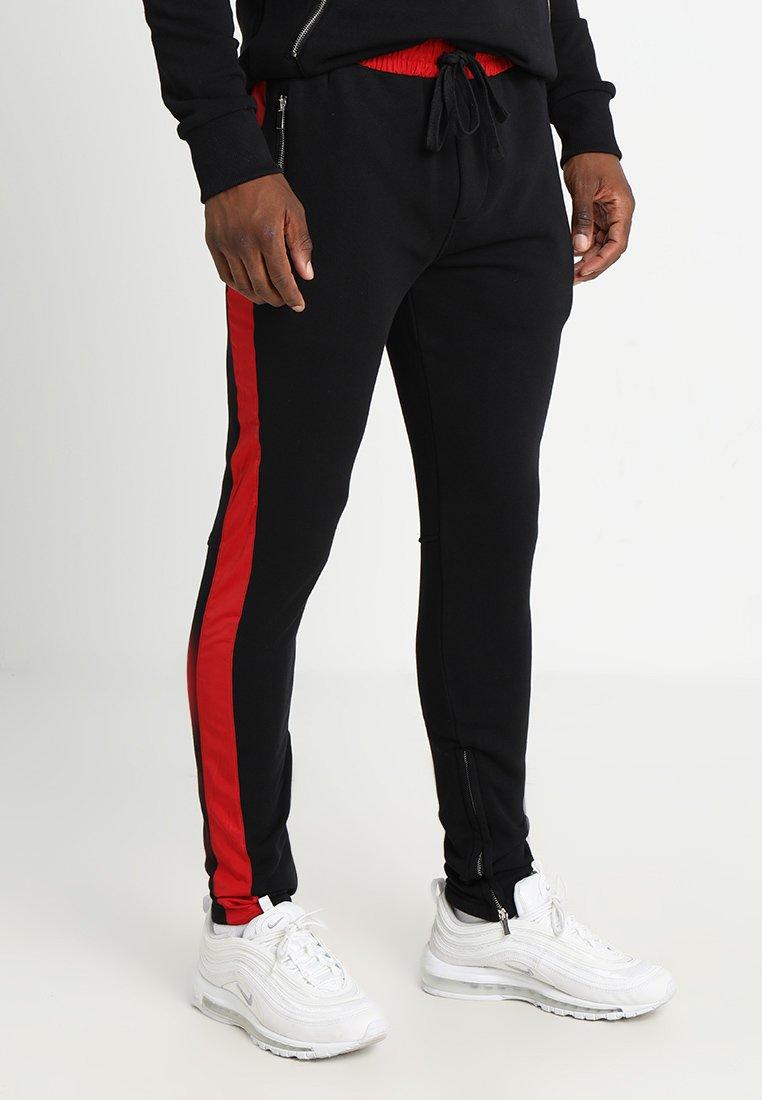 Pegador - TREVOR STRIPE PANTS - Tracksuit bottoms - black/red