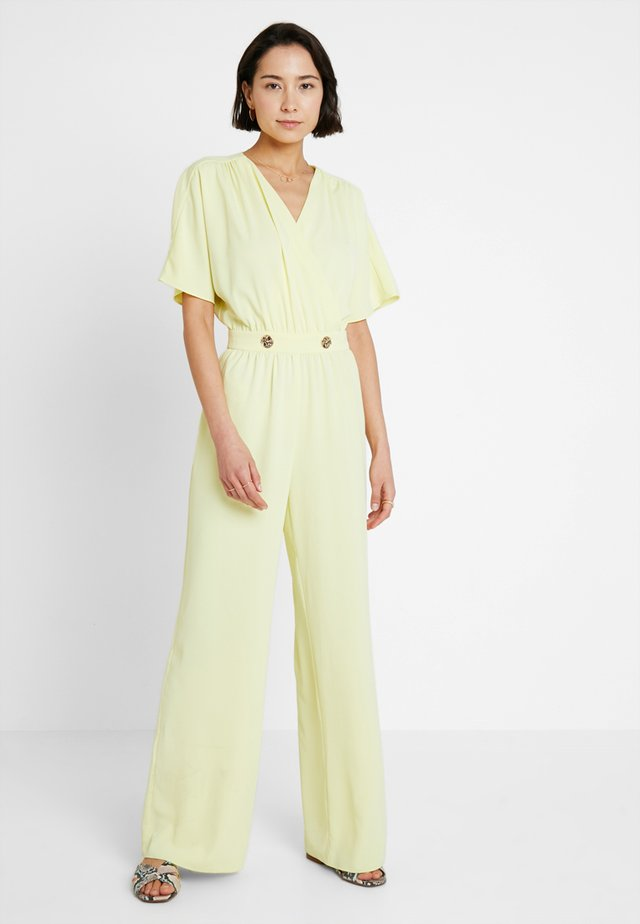 METALLIC BUTTONS - Jumpsuit - light yellow