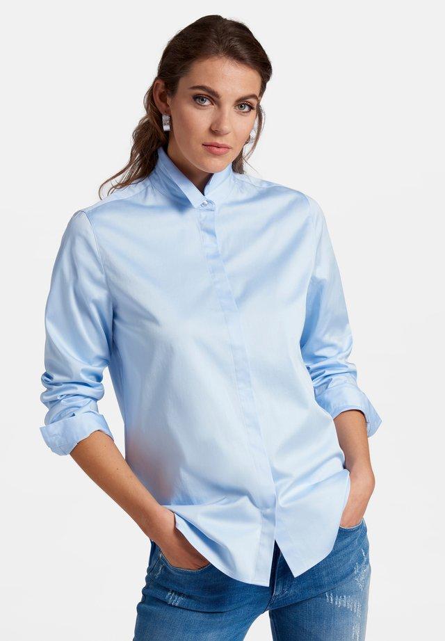 BLUSE IM OVERSIZED-SCHNITT - Button-down blouse - light blue