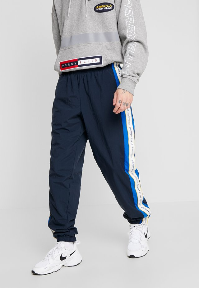 TRACK PANT - Tracksuit bottoms - dark sapphire