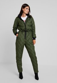 PEPPERCORN - SNOWSUIT HARLEQUIN ONE PIECE - Jumpsuit - dark green - 1