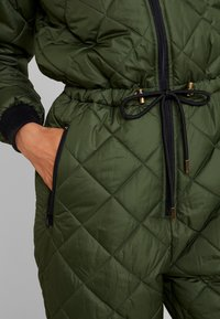 PEPPERCORN - SNOWSUIT HARLEQUIN ONE PIECE - Jumpsuit - dark green - 6