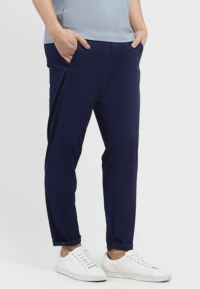 SET YOU FREE - Trousers - navy