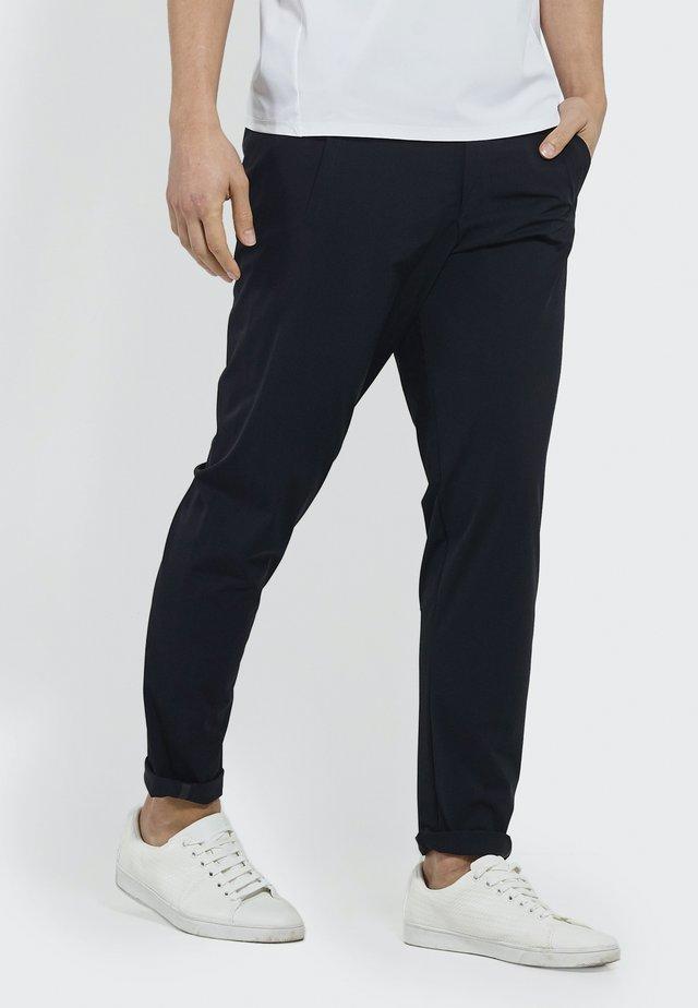 SET YOU FREE - Trousers - black