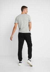 Pier One - Pantalones deportivos - black - 2