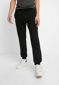 Pier One - Pantalones deportivos - black - 0