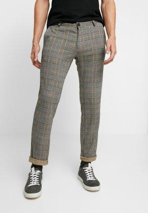 Pantalon classique - black/yellow