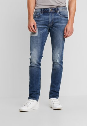 Jean slim - dyed denim