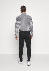 Pier One - Slim fit jeans - black denim - 2
