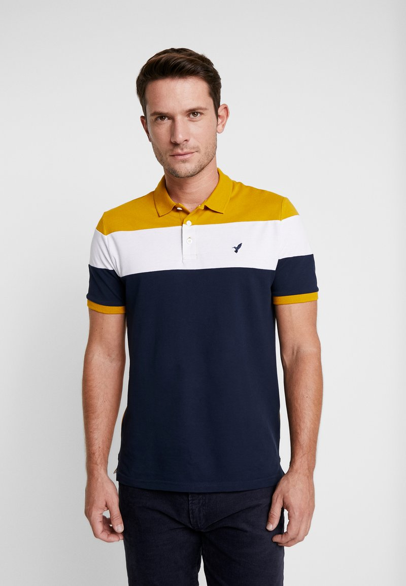 Pier One - Polo shirt - dark blue/mustard