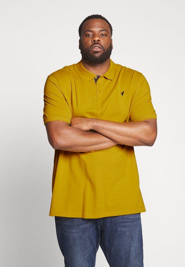 Poloshirt - mustard