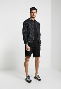 Piazza Italia - FELC - Teplákové kalhoty - black - 1