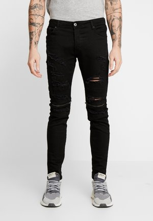 Vaqueros pitillo - black denim
