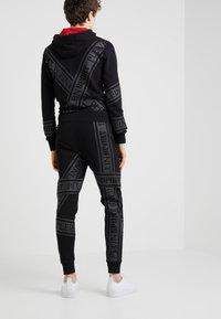 Plein Sport - JOGGING TROUSERS - Pantaloni sportivi - black - 2