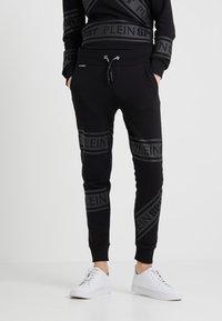 Plein Sport - JOGGING TROUSERS - Pantaloni sportivi - black - 0