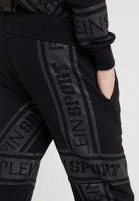 Plein Sport - JOGGING TROUSERS - Pantaloni sportivi - black - 4