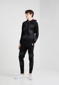 Plein Sport - JOGGING TROUSERS - Pantaloni sportivi - black - 1