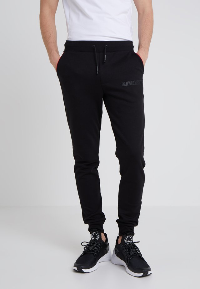 JOGGING TROUSERS STATEMENT - Spodnie treningowe - black