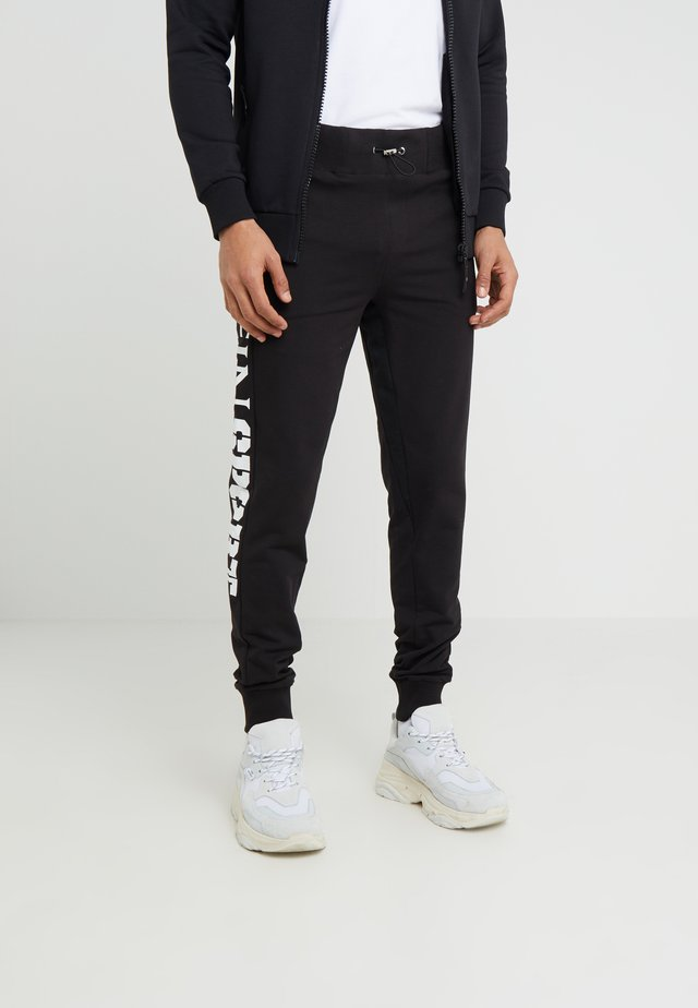 TROUSERS STATEMENT - Spodnie treningowe - black