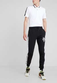 Plein Sport - ORIGINAL - Pantalon de survêtement - black - 0