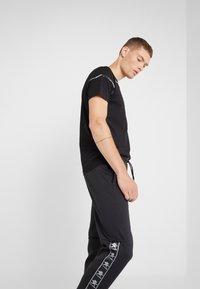 Plein Sport - Teplákové kalhoty - black - 3