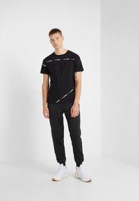 Plein Sport - Teplákové kalhoty - black - 1
