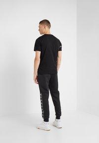 Plein Sport - Teplákové kalhoty - black - 2