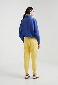 Polo Ralph Lauren - SEASONAL - Teplákové kalhoty - oasis yellow - 2