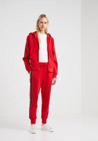 Polo Ralph Lauren - SEASONAL - Pantaloni sportivi - red - 1