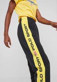 Polo Ralph Lauren - SPORT FREESTYLE - Pantalon de survêtement - black - 4