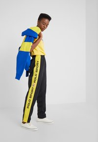 Polo Ralph Lauren - SPORT FREESTYLE - Pantalones deportivos - black - 1