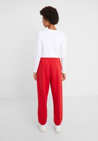 Polo Ralph Lauren - SEASONAL  - Pantaloni sportivi - red - 2