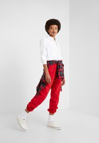 Polo Ralph Lauren - SEASONAL  - Pantaloni sportivi - red - 1