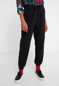 Polo Ralph Lauren - SEASONAL  - Pantalon de survêtement - black - 0