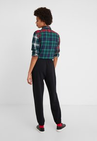 Polo Ralph Lauren - SEASONAL  - Tracksuit bottoms - black - 2