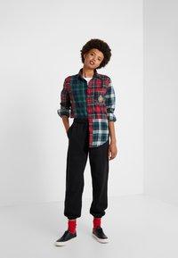 Polo Ralph Lauren - SEASONAL  - Pantalon de survêtement - black - 1