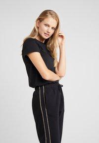 Polo Ralph Lauren - SEASONAL  - Pantaloni sportivi - black - 4