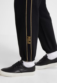 Polo Ralph Lauren - SEASONAL  - Tracksuit bottoms - black - 3