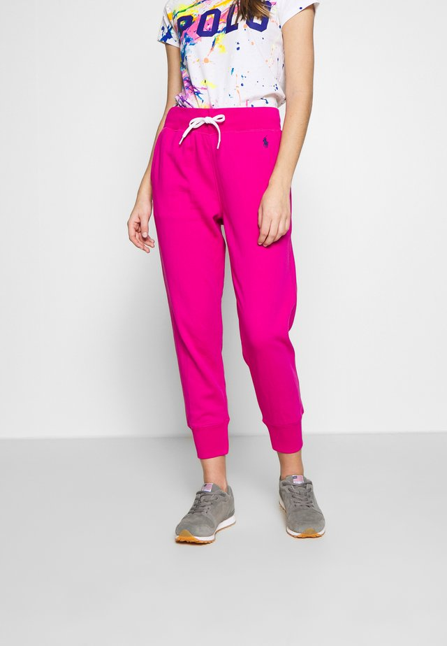 FEATHERWEIGHT - Tracksuit bottoms - accent pink
