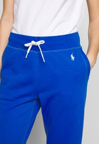 Polo Ralph Lauren - FEATHERWEIGHT - Tracksuit bottoms - heritage blue - 4