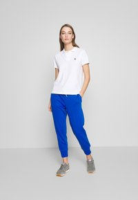 Polo Ralph Lauren - FEATHERWEIGHT - Tracksuit bottoms - heritage blue - 1